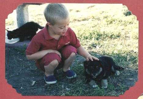 "Timo, 5, with Ursa (Minor) - he'd been hoping for a ""bigger one, sharp teeth."""