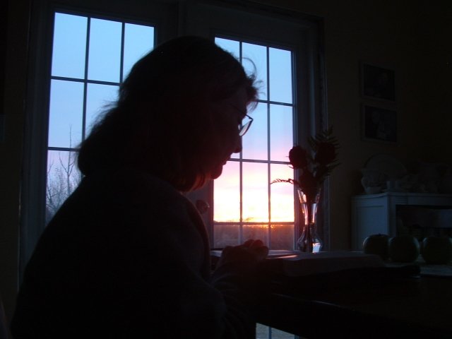 A picture my late son Paul took of me one morning. (I usually have a little more light to read by.)
